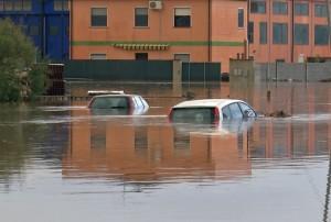Submerged cars are seen on a flooded street in San Gavino Monreale on Sardina island